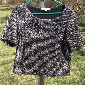 Sequins sweater top. Short sleeve. Soft lining.